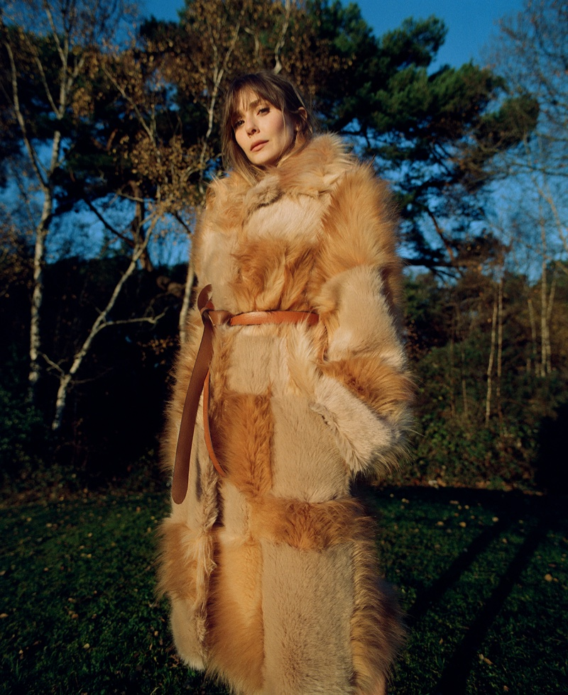 Posing outdoors, Elizabeth Olsen wears Stella McCartney coat. Photo: Amar Daved