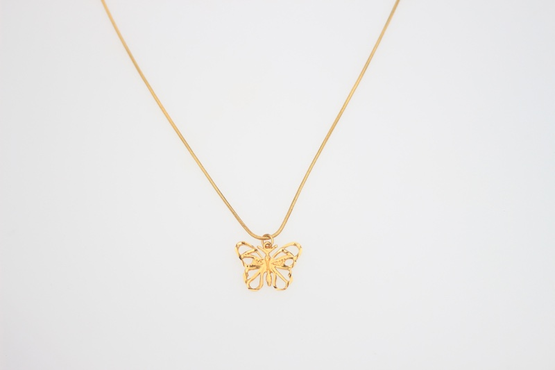 Gold Pendant Butterfly Necklace Grey Background