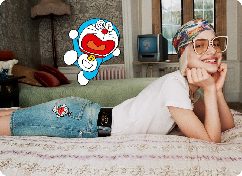 A model is all smiles wearing the Doraemon x Gucci collaboration.