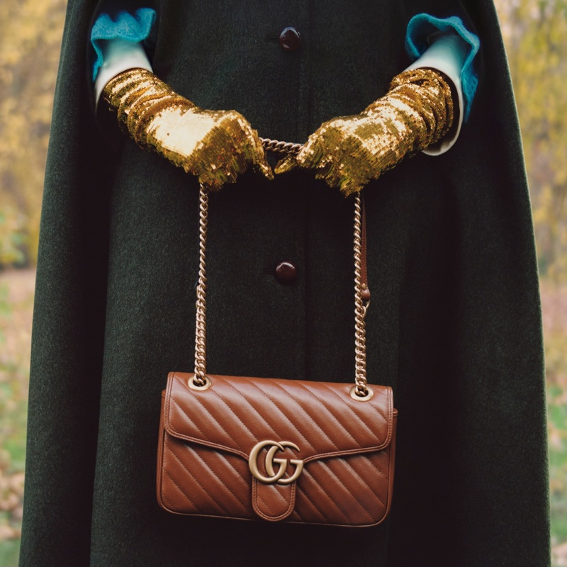 Celeste poses with Gucci GG Marmont bag.