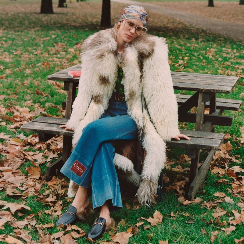 Alexa Chung poses in Gucci faux fur coat for the brand's Winter in the Park campaign.
