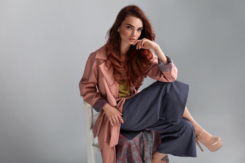 Model Layered Look Pink Jacket Grey Trousers Sitting