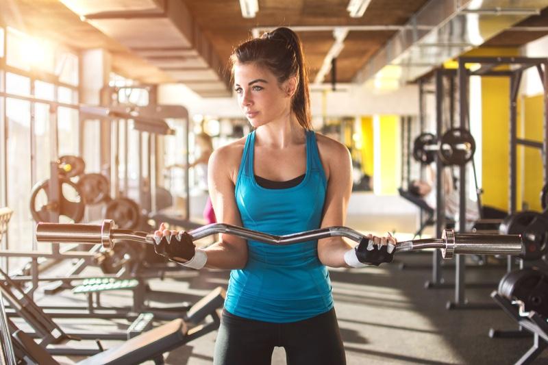 Model Posing Curl Bar Fitness Activewear