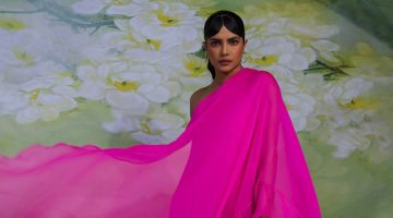 Draped in hot pink, Priyanka Chopra wears Valentino dress, Cartier jewelry, and Jimmy Choo heels.