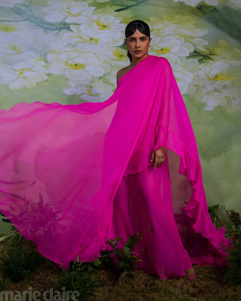Draped in hot pink, Priyanka Chopra wears Valentino dress, Cartier jewelry, and Jimmy Choo heels.