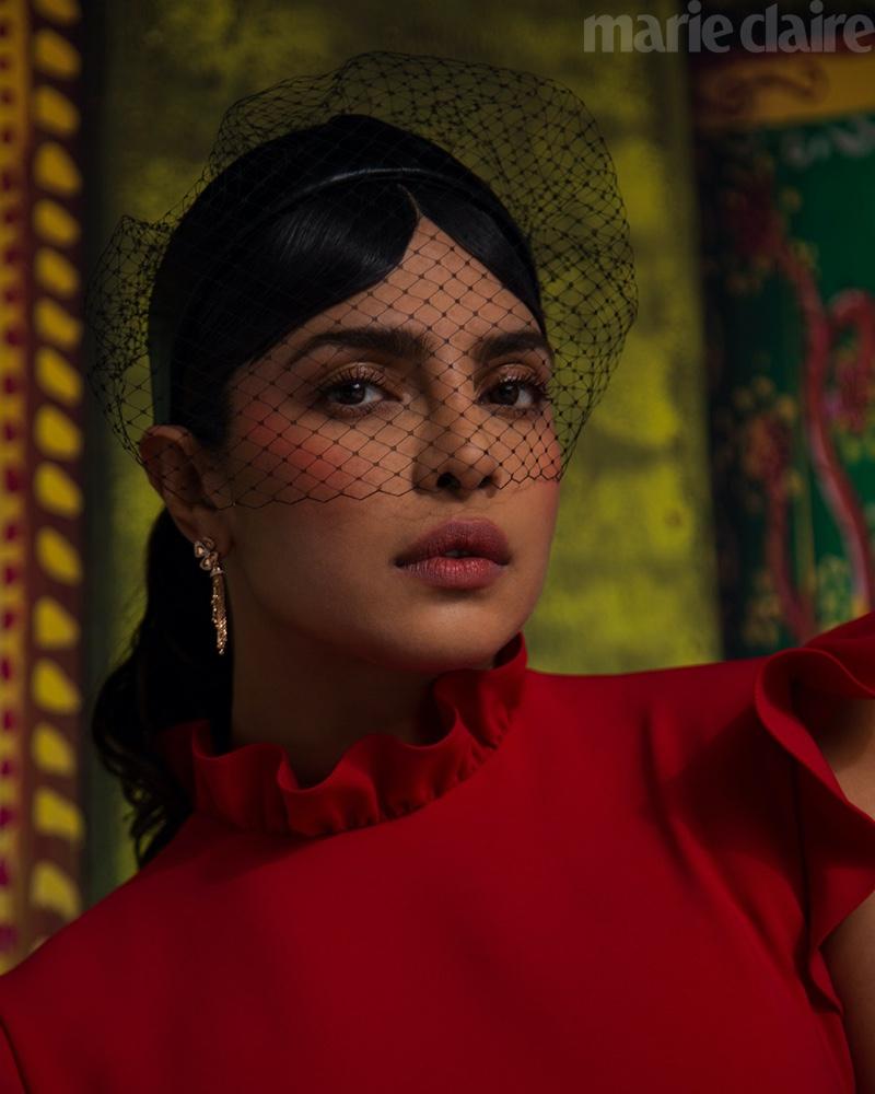 Priyanka Chopra poses in Christian Siriano dress, Dior veil, and Bulgari earrings.