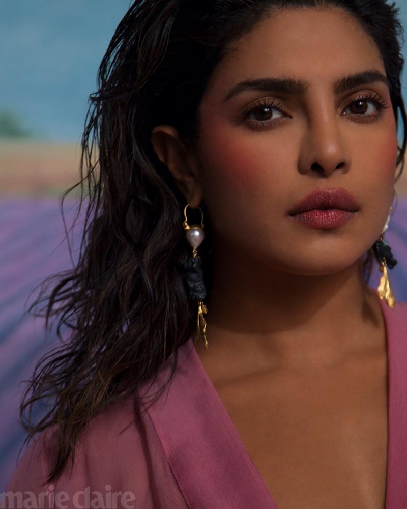 Ready for her closeup, Priyanka Chopra wears Dior dress and earrings.