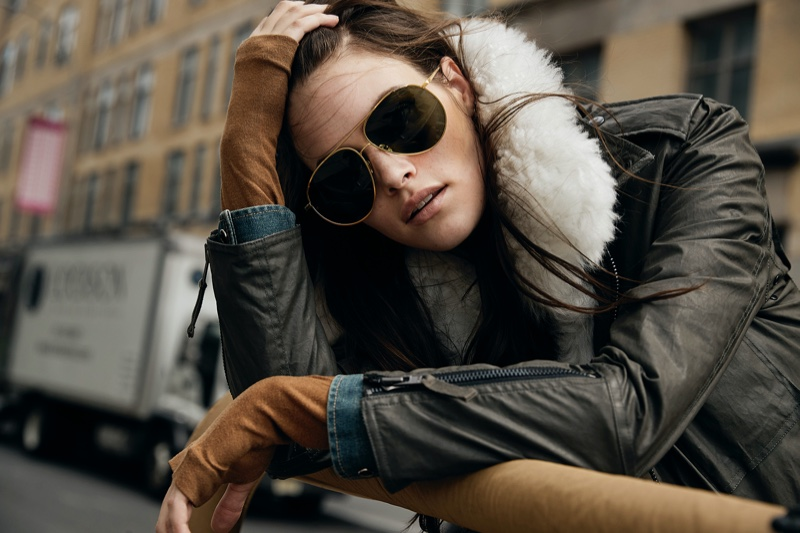 Rocking aviator sunglasses and a shearling jacket, Vanessa Moody poses in SAM fall-winter 2020 campaign.