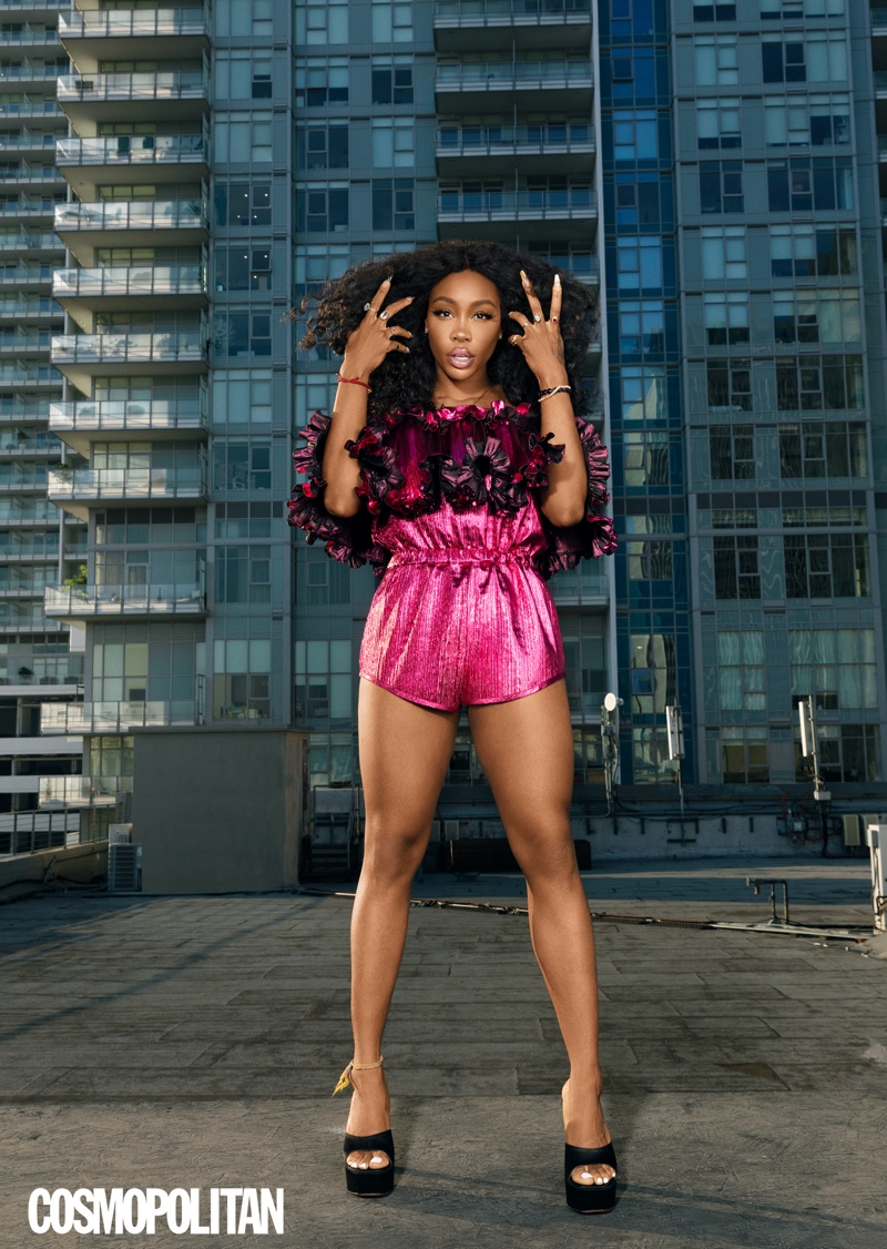 Looking pretty in pink, SZA poses in Alexandre Vauthier jumpsuit with Amina Muaddi heels.