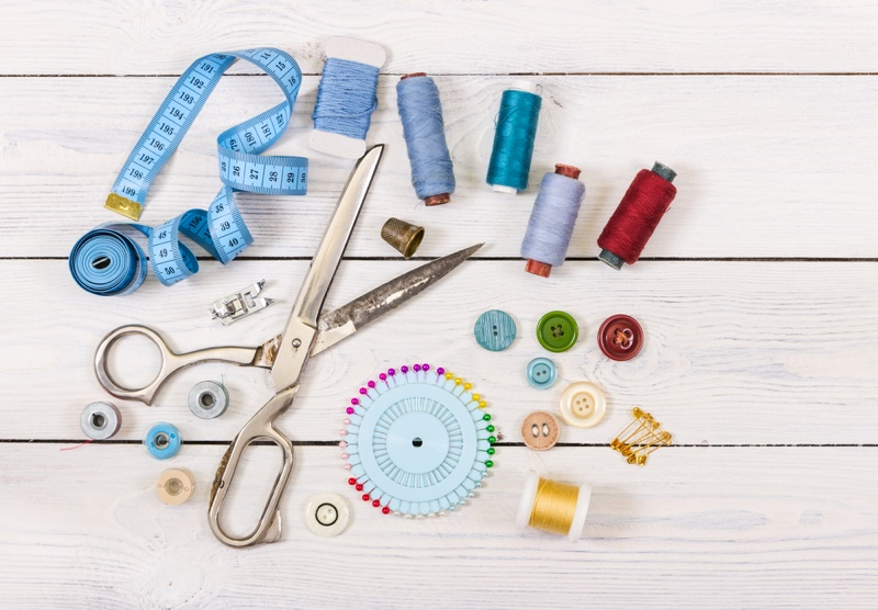 Sewing Kit Wooden Backdrop Scissors Thread Measuring Tape Buttons