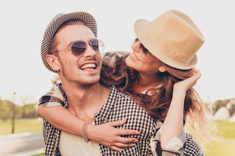 Smiling Couple Hats Sunglasses Outdoors