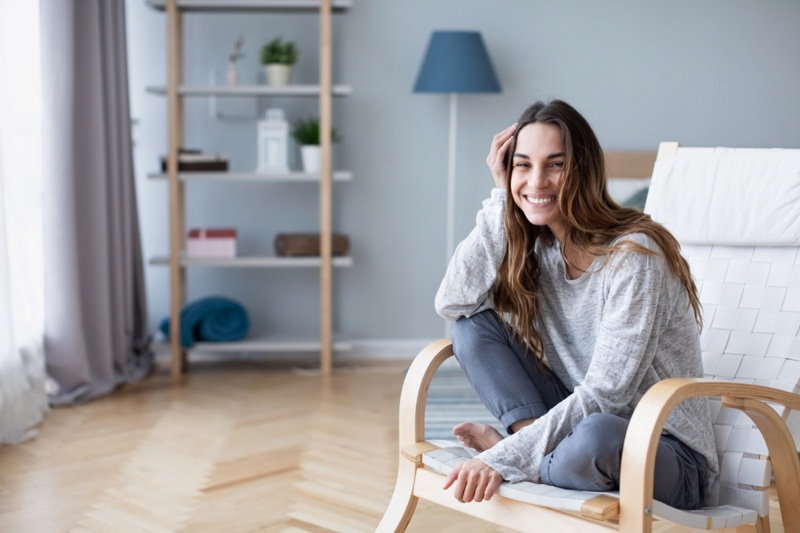 Smiling Woman Sitting Home