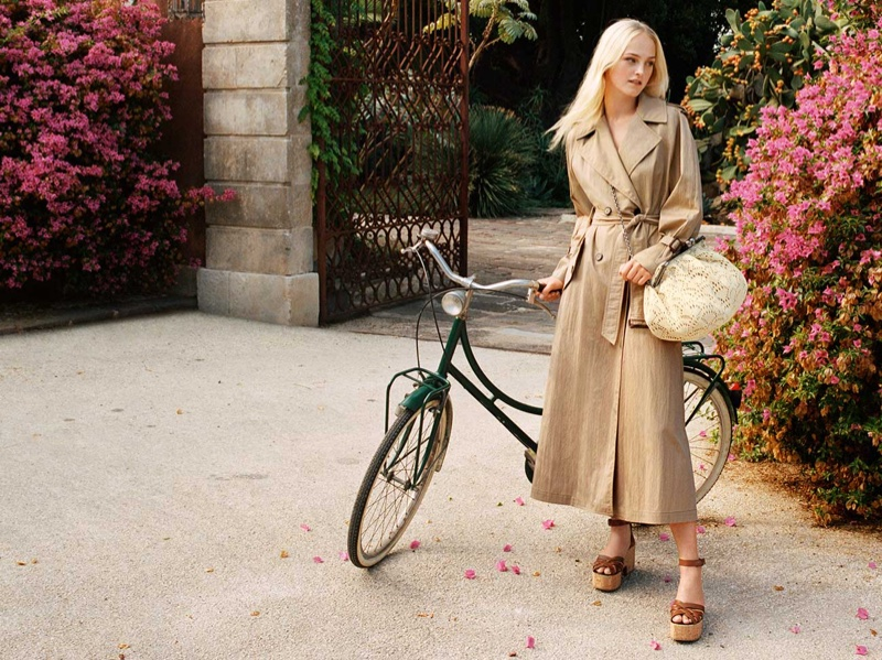 Jean Campbell poses in a trench coat for Weekend Max Mara spring-summer 2021 campaign.