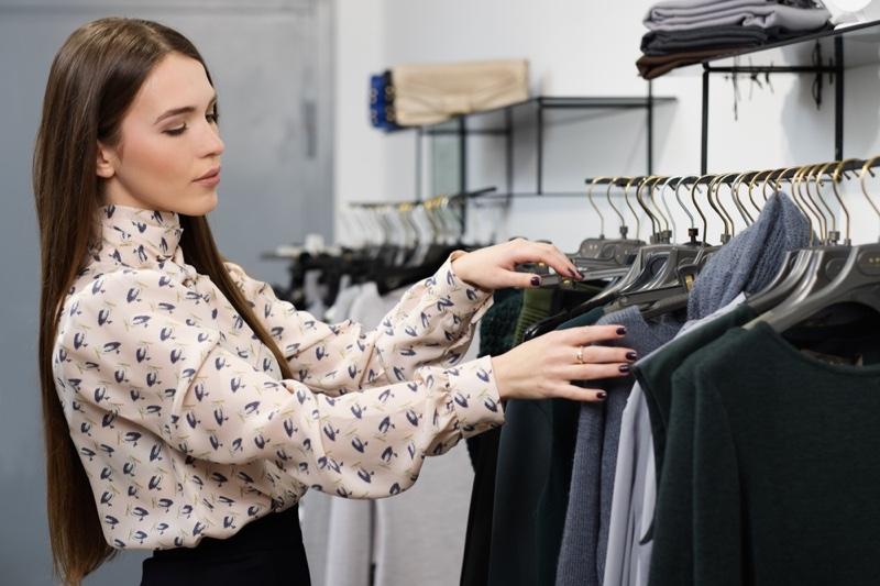 Woman Browsing Clothing Rack Printed Shirt