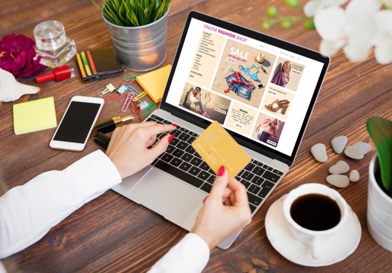 Woman Browsing Clothing Store Online Desk Laptop