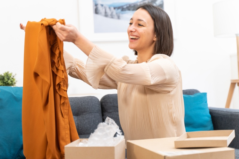 Woman Opening Clothes Box