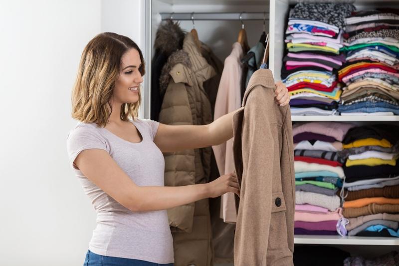 Woman Smiling Looking Organizing Closet
