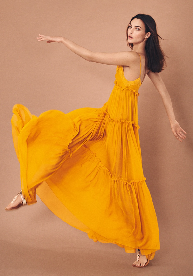 Alberta Ferretti features tiered maxi dress in spring-summer 2021 campaign.