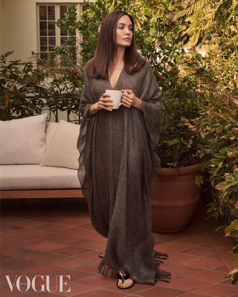 Actress Angelina Jolie wears vintage Brunello Cucinelli kaftan and Tom Ford sandals.