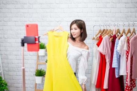 Asian Woman Posing Yellow Dress Clothes Hangers