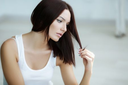 Attractive Woman Looking Hair Unhappy