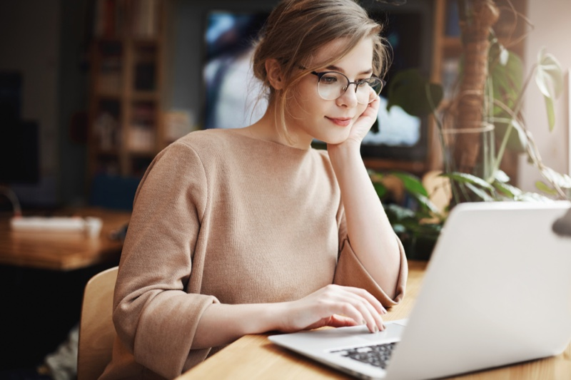 Attractive Woman Looking Laptop Wearing Glasses
