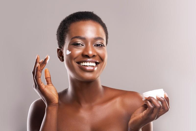 Black Model Short Natural Hair Skincare Product Smile
