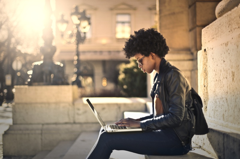 Black Woman Afro Hair Writing Laptop