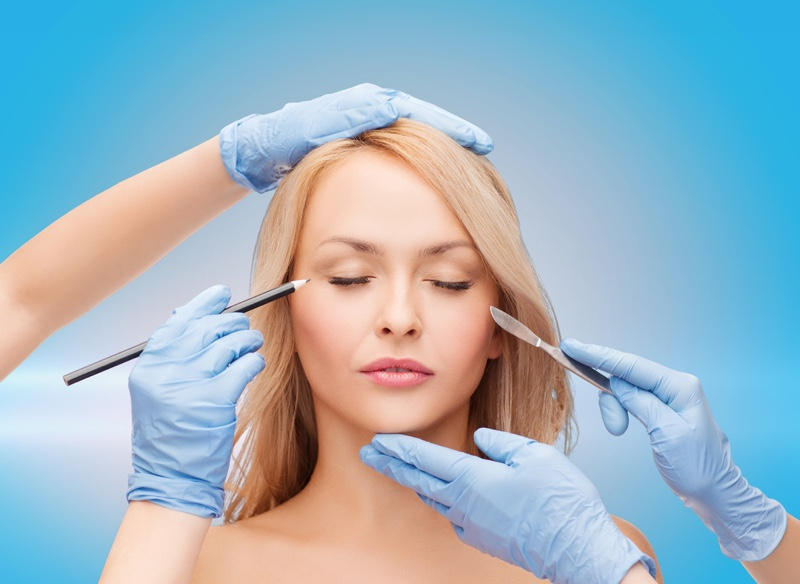 Blonde Woman Plastic Surgery Gloves Scalpel Concept