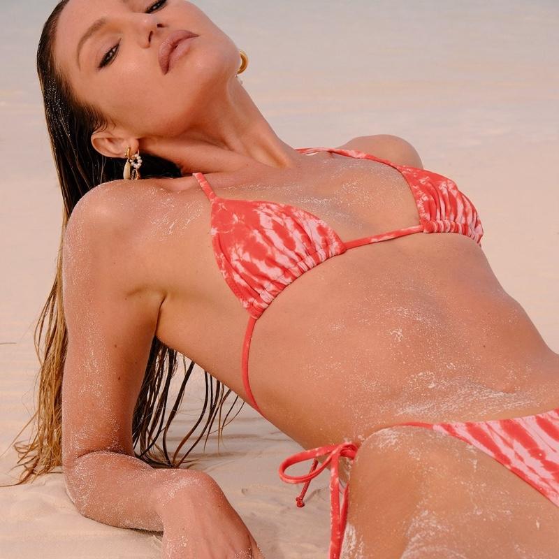 Candice Swanepoel models Tropic of C Praia bikini top and bottoms.