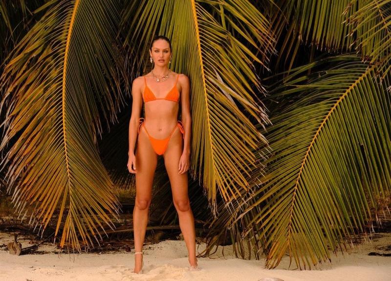 Candice Swanepoel wears Tropic of C Equator top and Praia bottom in papaya.