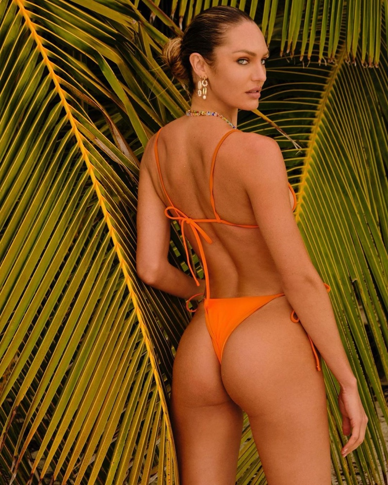 Model Candice Swanepoel flaunts her toned figure in Tropic of C swimsuit.
