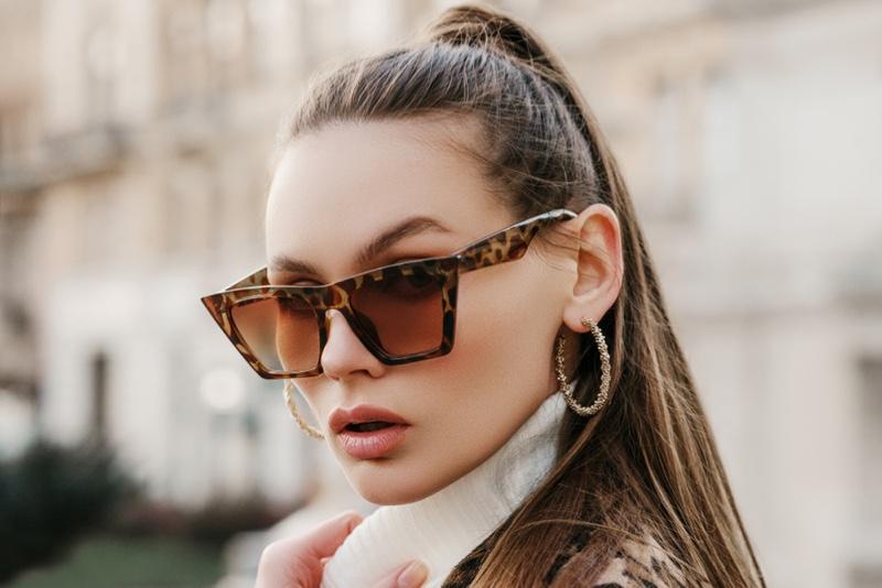 Closeup Model Hoop Earrings Animal Print Sunglasses