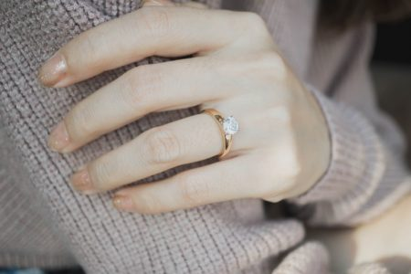 Closeup Woman's Hand Engagement Ring Gold Band