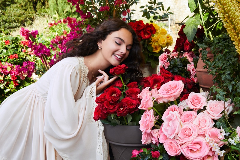 BEHIND THE SCENES: Smelling flowers, Deva Cassel poses on set of Dolce & Gabbana fragrance shoot.