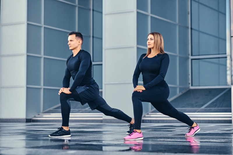 Fitness Model Couple Lunges Workout Clothes