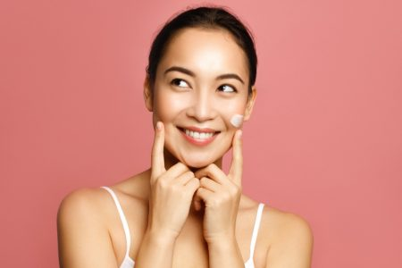 Happy Asian Woman Skincare Face Product