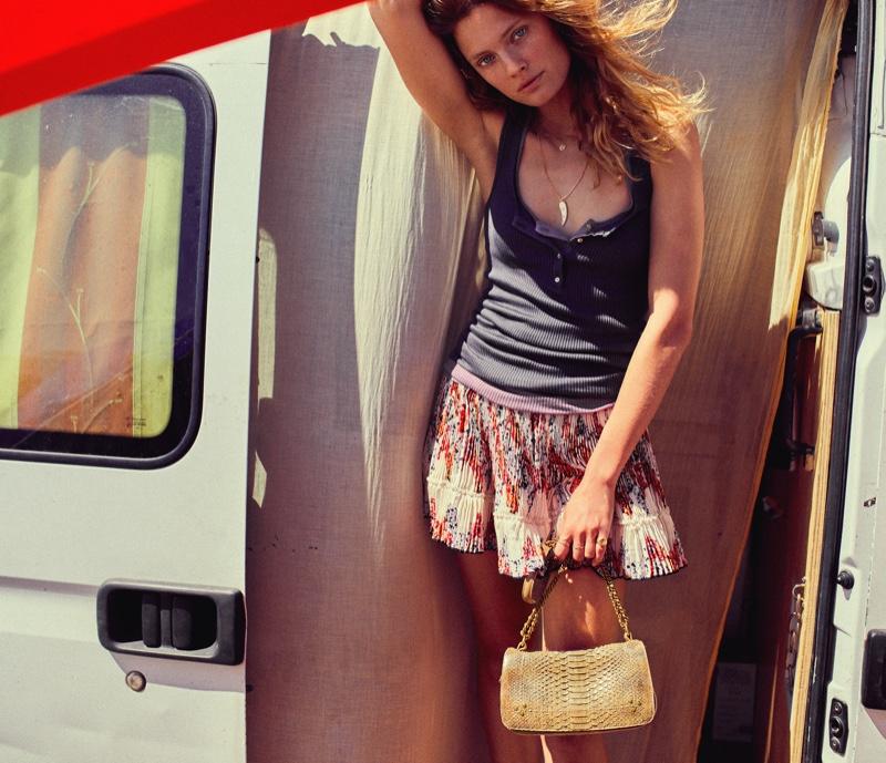 Model Constance Jablonski poses in a van for Jerome Dreyfuss spring-summer 2021 campaign.