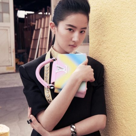 Liu Yifei poses with Louis Vuitton Capucines mini bag in rainbow gradient.