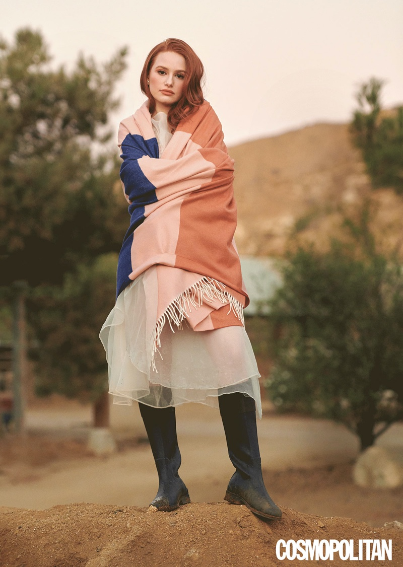 Actress Madelaine Petsch wears Sandy Ling dress with Calle Del Mar Bottoms and La Chameau boots.