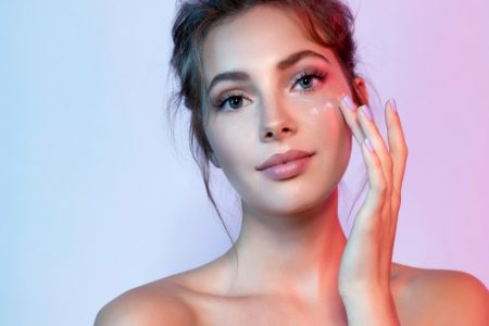 Model Applying Cream Face Beauty