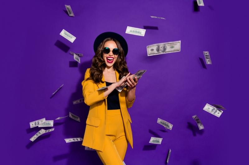 Model Yellow Pant Suit Throwing Money