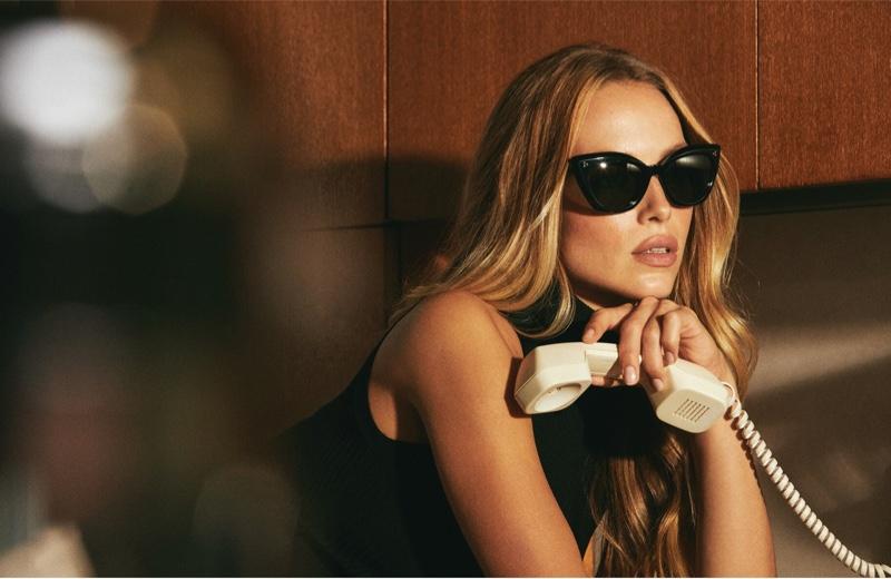 Hannah Ferguson wears Oliver Peoples Laiya cat-eye sunglasses.