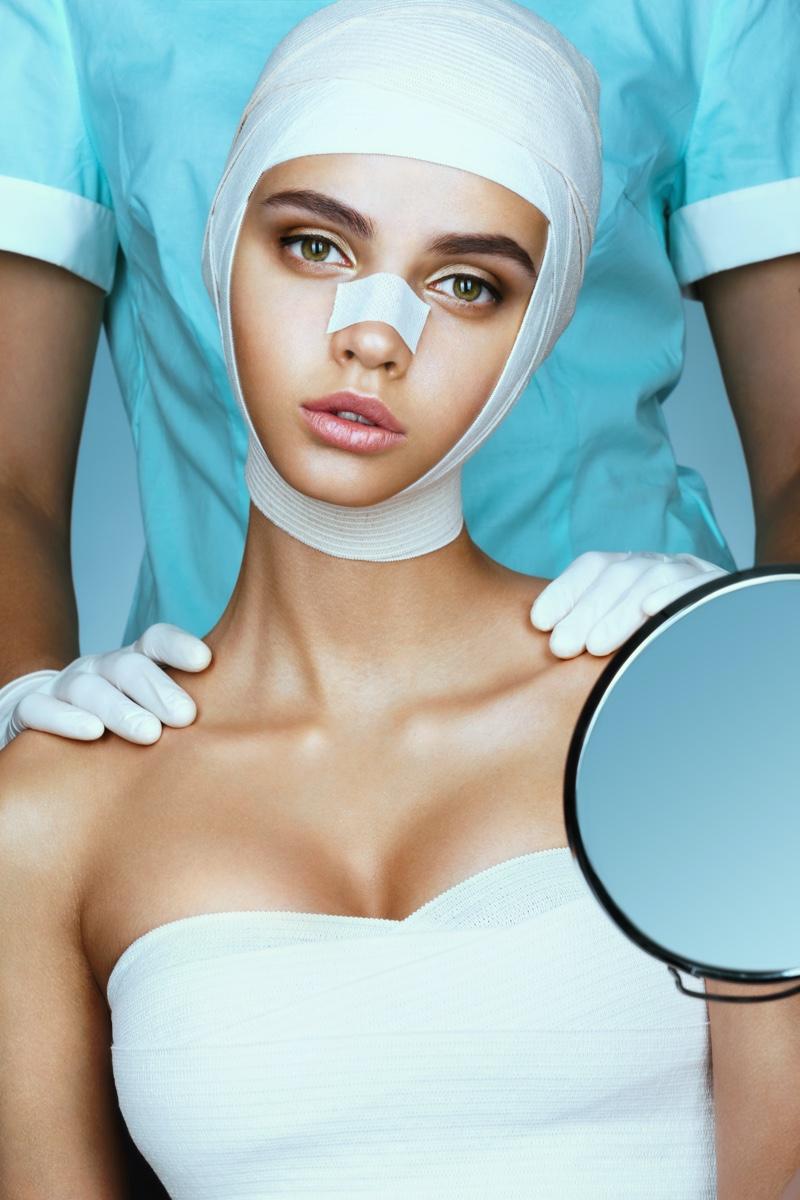 Plastic Surgery Concept model Bandages Chest Nose