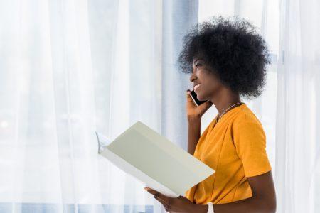 Smiling African American Woman Phone Folder Yellow Top