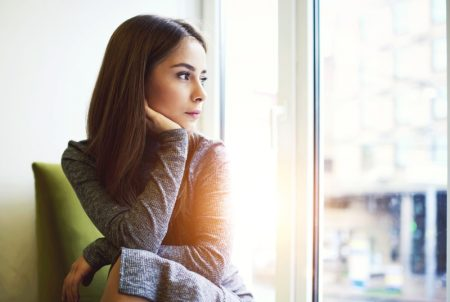 Thoughtful Depressed Woman Looking Out Window