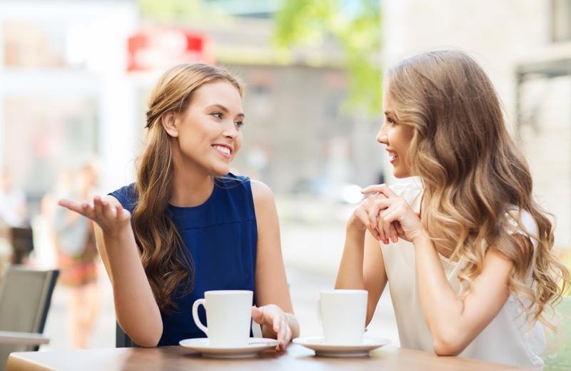 Two women Talking Outdoors Cups