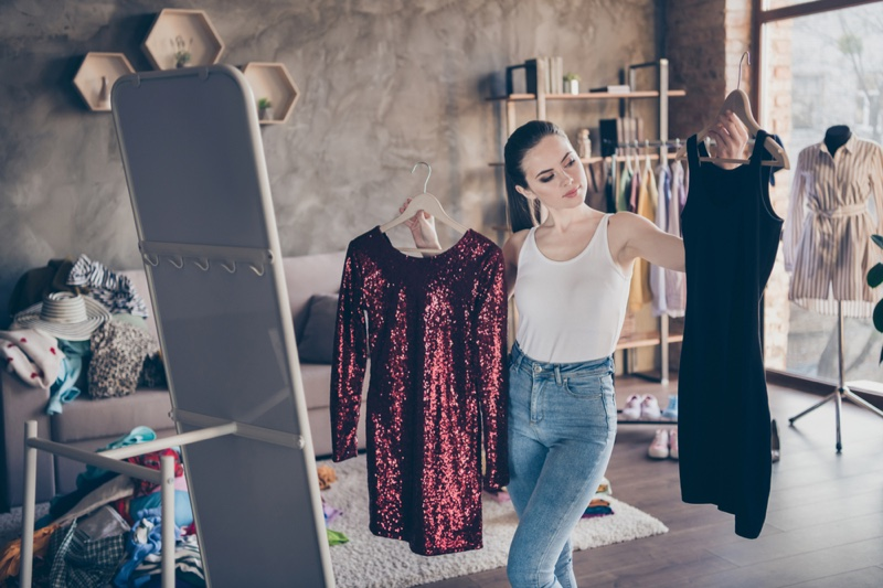 Woman Choosing Outfit Two dresses Decision