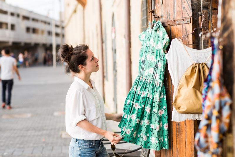 Woman Looking Dress Shop