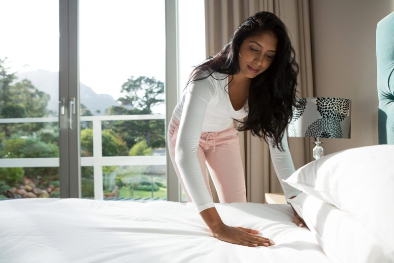 Woman Making Bed